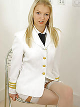 Only Tease Pics: Sexy blonde Sam in pilots uniform with stockings