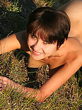 Lovely teen girl with charming smile wants to demonstrate the art of posing nude on the nature.