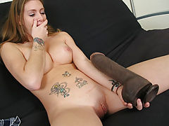 Jenna inserting a giant dildo