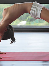 X-Art Pics: Watch sexy cutie Caprice do yoga in the nude X-Art style!