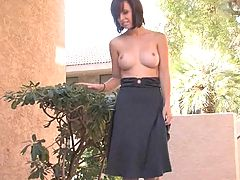 Hayden takes off her dress outside