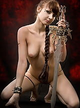 Fantasy Pics: Fantasy Girl Sexy warrior girl with the sword and tatoos on her back and belly