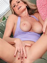 Freckled milf Jade Jamison exposes her bald slit.
