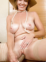 Alluring milf Samantha Stone tortures her cougar snatch with a massive sex toy