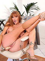 High.Heels Babes: Darla Crane, Brunette Anilos Darla Crane stretches her mature pussy with a glass toy in the office