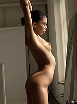 Babes Pics: A perfect little ballerina admires herself in the mirror as she stretches her slender body.