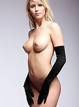 X-Art Pussy: Nicole poses with picture perfect elegance wearing nothing but a pair of black satin gloves.