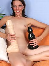 Alizia pounds two giant dildos