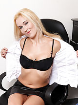 Milf Babes: Cock starved executive fondles her juice dripping pussy at her desk