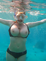 Bikini Pussy: Kelly gets naked underwater and uses her 34ff's as floatation devices.