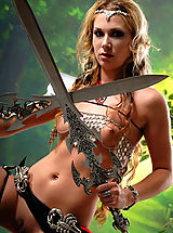 Fantasy Babes: Sexy topless blonde amazon babe posing with two swords and masturbates