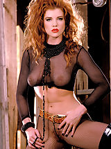 Suze Randall Pics: Julia Hayes gets kinky with see through stockings and fishnets and her fiery hair gone wild!
