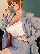 Babe Ass, Busty redhead teacher Darla Crane has hot sex on her desk with one of her students.