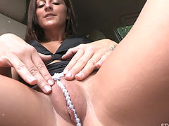 Clitoris Size Gallery, Melissa sits in a car with a sweet camel toe with pearls