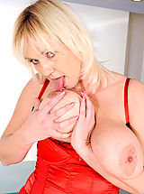 Anilos Pussy: Kimi, Blonde cougar Kimi flaunts her big tits and plays with her pussy using her fingers