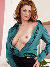 Horny Anilos woman peels off her business attire and exposes her big tits and milf pussy
